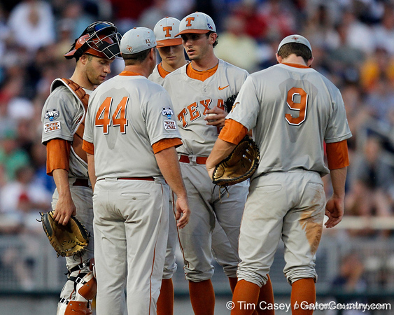 Texas players huddle during the Gators' 8-4 win against the Texas Longhorns in the College World Series on Saturday, June 18, 2011 at TD Ameritrade Park in Omaha, Neb. / Gator Country photo by Tim Casey