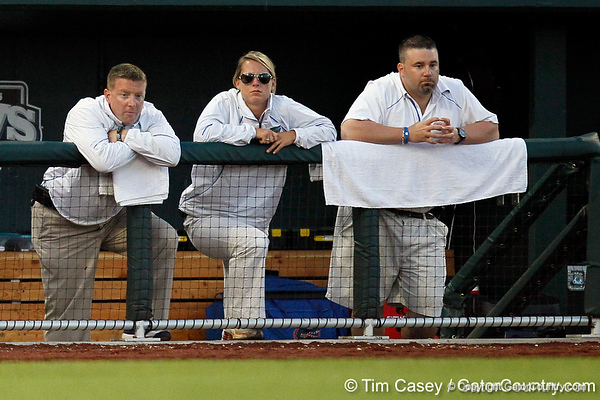 Florida baseball athletic trainer John Barrett and director of baseball operations Samantha Scales watch from the dugout during the Gators' 8-4 win against the Texas Longhorns in the College World Series on Saturday, June 18, 2011 at TD Ameritrade Park in Omaha, Neb. / Gator Country photo by Tim Casey