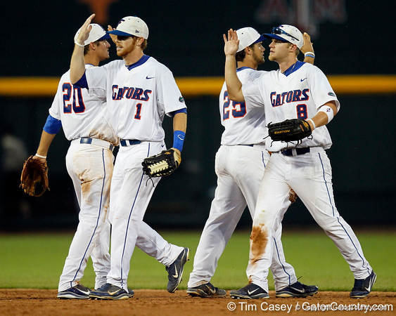 Florida senior Bryson Smith and junior outfielder Daniel Pigott celebrate after the Gators' 8-4 win against the Texas Longhorns in the College World Series on Saturday, June 18, 2011 at TD Ameritrade Park in Omaha, Neb. / Gator Country photo by Tim Casey