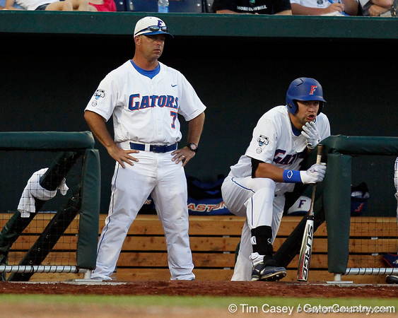Florida head coach Kevin O'Sullivan watches from the dugout during the Gators' 8-4 win against the Texas Longhorns in the College World Series on Saturday, June 18, 2011 at TD Ameritrade Park in Omaha, Neb. / Gator Country photo by Tim Casey