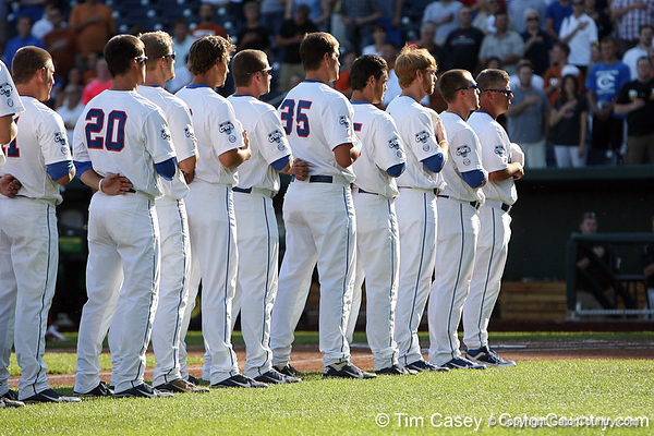 Florida players stand for the national anthem before the Gators' game against the Texas Longhorns in the College World Series on Saturday, June 18, 2011 at TD Ameritrade Park in Omaha, Neb. / Gator Country photo by Tim Casey