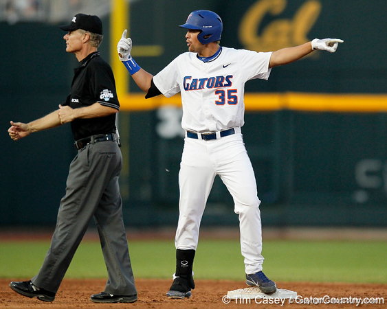 Florida sophomore Brian Johnson pleads that his hit should have been ruled a home run during the Gators' 8-4 win against the Texas Longhorns in the College World Series on Saturday, June 18, 2011 at TD Ameritrade Park in Omaha, Neb. / Gator Country photo by Tim Casey
