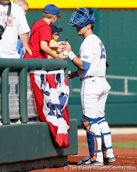Florida junior catcher Ben McMahan signs autographs before the Gators' game against the Texas Longhorns in the College World Series on Saturday, June 18, 2011 at TD Ameritrade Park in Omaha, Neb. / Gator Country photo by Tim Casey