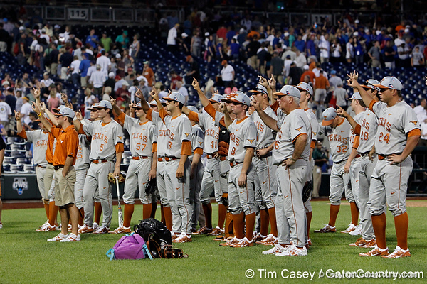 """Texas players sing """"The Eyes of Texas"""" after the Gators' 8-4 win against the Texas Longhorns in the College World Series on Saturday, June 18, 2011 at TD Ameritrade Park in Omaha, Neb. / Gator Country photo by Tim Casey"""