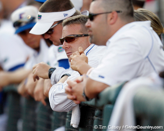 Florida baseball athletic trainer John Barrett watches from the dugout during the Gators' game against the Texas Longhorns in the College World Series on Saturday, June 18, 2011 at TD Ameritrade Park in Omaha, Neb. / Gator Country photo by Tim Casey