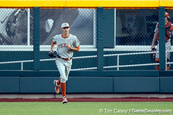 Texas pitcher Hoby Milner runs in from the bullpen during the Gators' game against the Texas Longhorns in the College World Series on Saturday, June 18, 2011 at TD Ameritrade Park in Omaha, Neb. / Gator Country photo by Tim Casey