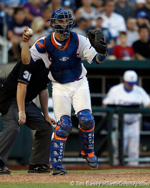 Florida sophomore catcher Mike Zunino throw the ball during the Gators' 8-4 win against the Texas Longhorns in the College World Series on Saturday, June 18, 2011 at TD Ameritrade Park in Omaha, Neb. / Gator Country photo by Tim Casey