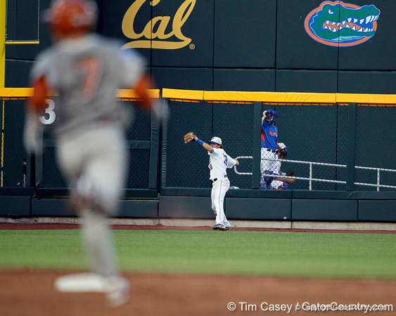 Florida junior outfielder Tyler Thompson throws the ball to the infield during the Gators' 8-4 win against the Texas Longhorns in the College World Series on Saturday, June 18, 2011 at TD Ameritrade Park in Omaha, Neb. / Gator Country photo by Tim Casey