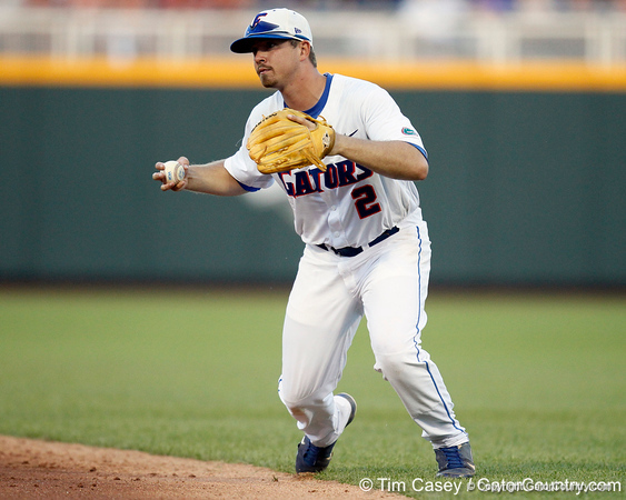 Florida senior Josh Adams fields a ground ball during the Gators' 8-4 win against the Texas Longhorns in the College World Series on Saturday, June 18, 2011 at TD Ameritrade Park in Omaha, Neb. / Gator Country photo by Tim Casey