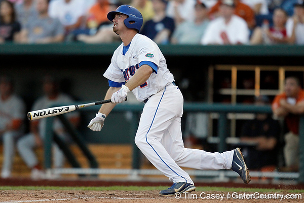Florida senior Josh Adams flies out to left field during the Gators' game against the Texas Longhorns in the College World Series on Saturday, June 18, 2011 at TD Ameritrade Park in Omaha, Neb. / Gator Country photo by Tim Casey
