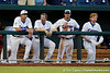 Brian Johnson, Josh Adams, Cody Dent and Hudson Randall watch from the dugout during the Gators' 8-4 win against the Texas Longhorns in the College World Series on Saturday, June 18, 2011 at TD Ameritrade Park in Omaha, Neb. / Gator Country photo by Tim Casey