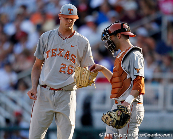 Texas pitcher Taylor Jungmann takes the ball from Jacob Felts during the Gators' game against the Texas Longhorns in the College World Series on Saturday, June 18, 2011 at TD Ameritrade Park in Omaha, Neb. / Gator Country photo by Tim Casey