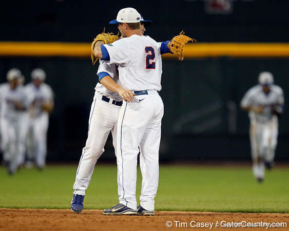 Florida sophomore shortstop Nolan Fontana and senior Josh Adams hug after the Gators' 8-4 win against the Texas Longhorns in the College World Series on Saturday, June 18, 2011 at TD Ameritrade Park in Omaha, Neb. / Gator Country photo by Tim Casey