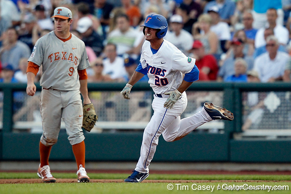 Florida sophomore infielder Cody Dent runs out a double during the Gators' game against the Texas Longhorns in the College World Series on Saturday, June 18, 2011 at TD Ameritrade Park in Omaha, Neb. / Gator Country photo by Tim Casey
