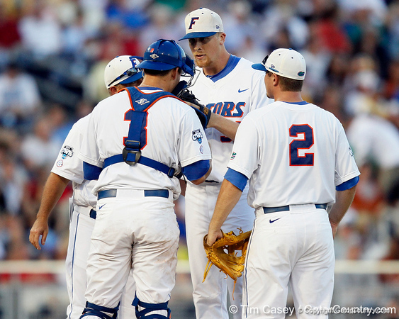 Florida junior pitcher Greg Larson talks with head coach Kevin O'Sullivan, Mike Zunino and Josh Adams during the Gators' 8-4 win against the Texas Longhorns in the College World Series on Saturday, June 18, 2011 at TD Ameritrade Park in Omaha, Neb. / Gator Country photo by Tim Casey