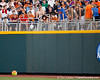 Fans play with a beach ball on a string during the Gators' 8-4 win against the Texas Longhorns in the College World Series on Saturday, June 18, 2011 at TD Ameritrade Park in Omaha, Neb. / Gator Country photo by Tim Casey