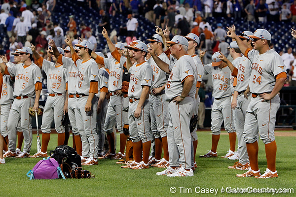 "Texas players sing ""The Eyes of Texas"" after the Gators' 8-4 win against the Texas Longhorns in the College World Series on Saturday, June 18, 2011 at TD Ameritrade Park in Omaha, Neb. / Gator Country photo by Tim Casey"