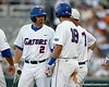 Florida senior Josh Adams talks with Kevin O'Sullivan and Tyler Thompson during the Gators' game against the Texas Longhorns in the College World Series on Saturday, June 18, 2011 at TD Ameritrade Park in Omaha, Neb. / Gator Country photo by Tim Casey