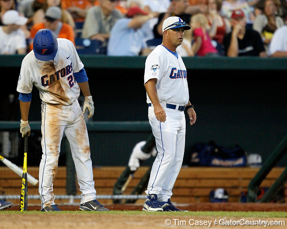 Florida head coach Kevin O'Sullivan talks with sophomore infielder Cody Dent during the Gators' 8-4 win against the Texas Longhorns in the College World Series on Saturday, June 18, 2011 at TD Ameritrade Park in Omaha, Neb. / Gator Country photo by Tim Casey