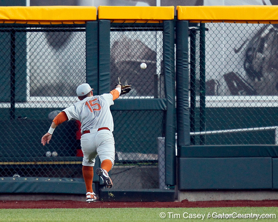 Texas right fielder Mark Payton chases a fly ball during the Gators' game against the Texas Longhorns in the College World Series on Saturday, June 18, 2011 at TD Ameritrade Park in Omaha, Neb. / Gator Country photo by Tim Casey