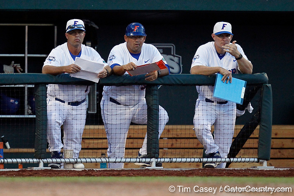 Kevin O'Sullivan, Craig Bell and Don Norris watch during the Gators' 8-4 win against the Texas Longhorns in the College World Series on Saturday, June 18, 2011 at TD Ameritrade Park in Omaha, Neb. / Gator Country photo by Tim Casey