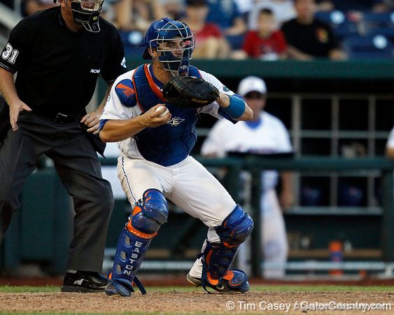 Florida sophomore catcher Mike Zunino controls the ball during the Gators' 8-4 win against the Texas Longhorns in the College World Series on Saturday, June 18, 2011 at TD Ameritrade Park in Omaha, Neb. / Gator Country photo by Tim Casey