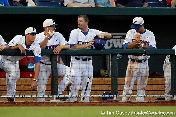 Zack Powers, Jeff Moyer, Josh Adams and Cody Dent watch from the dugout during the Gators' 8-4 win against the Texas Longhorns in the College World Series on Saturday, June 18, 2011 at TD Ameritrade Park in Omaha, Neb. / Gator Country photo by Tim Casey