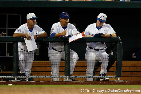 Kevin O'Sullivan, Craig Bell and Don Norris watch from the dugout during the Gators' 8-4 win against the Texas Longhorns in the College World Series on Saturday, June 18, 2011 at TD Ameritrade Park in Omaha, Neb. / Gator Country photo by Tim Casey
