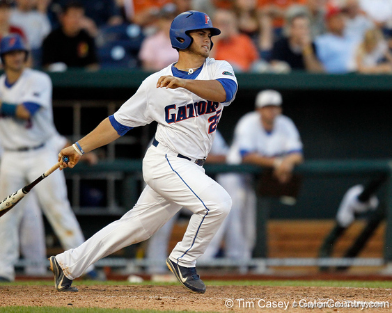 Florida junior Preston Tucker follows through on a ground ball during the Gators' 8-4 win against the Texas Longhorns in the College World Series on Saturday, June 18, 2011 at TD Ameritrade Park in Omaha, Neb. / Gator Country photo by Tim Casey