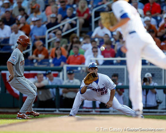 Florida junior Preston Tucker catches a pickoff attempt during the Gators' game against the Texas Longhorns in the College World Series on Saturday, June 18, 2011 at TD Ameritrade Park in Omaha, Neb. / Gator Country photo by Tim Casey