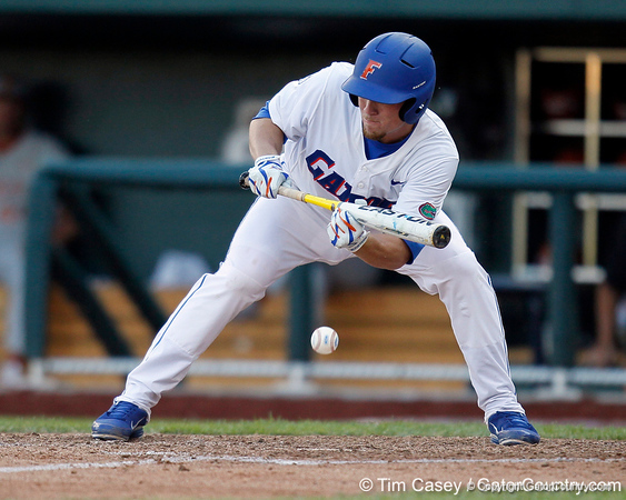 Florida sophomore shortstop Nolan Fontana bunts a pitch during the Gators' game against the Texas Longhorns in the College World Series on Saturday, June 18, 2011 at TD Ameritrade Park in Omaha, Neb. / Gator Country photo by Tim Casey