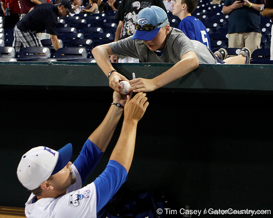 Florida freshman pitcher Karsten Whitson signs an autograph the Gators' 8-4 win against the Texas Longhorns in the College World Series on Saturday, June 18, 2011 at TD Ameritrade Park in Omaha, Neb. / Gator Country photo by Tim Casey