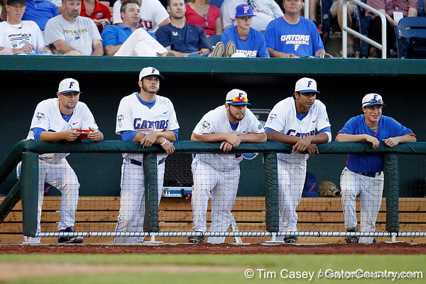 Karsten Whitson, Daniel Gibson, Alex Panteliodis and Vickash Ramjit watch during the Gators' 8-4 win against the Texas Longhorns in the College World Series on Saturday, June 18, 2011 at TD Ameritrade Park in Omaha, Neb. / Gator Country photo by Tim Casey