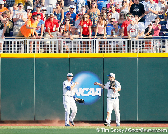 Florida senior Bryson Smith gets congratulated by Daniel Pigott after catching a fly ball during the Gators' game against the Texas Longhorns in the College World Series on Saturday, June 18, 2011 at TD Ameritrade Park in Omaha, Neb. / Gator Country photo by Tim Casey