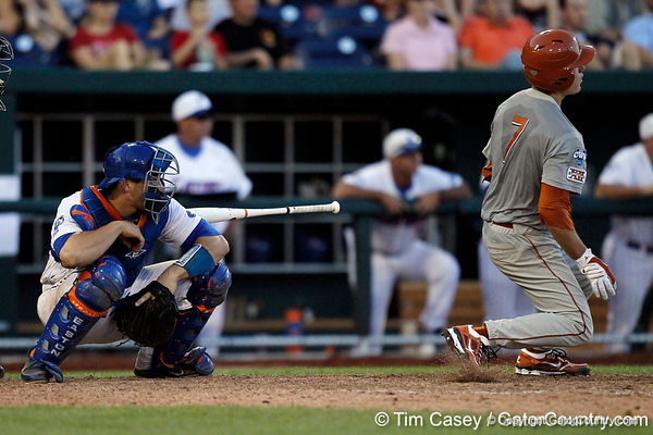 Florida sophomore catcher Mike Zunino avoids a bat during the Gators' 8-4 win against the Texas Longhorns in the College World Series on Saturday, June 18, 2011 at TD Ameritrade Park in Omaha, Neb. / Gator Country photo by Tim Casey