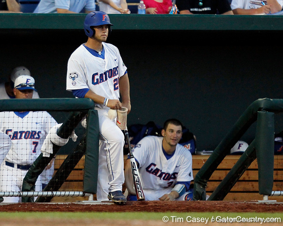 Florida junior Preston Tucker watches from the dugout during the Gators' 8-4 win against the Texas Longhorns in the College World Series on Saturday, June 18, 2011 at TD Ameritrade Park in Omaha, Neb. / Gator Country photo by Tim Casey