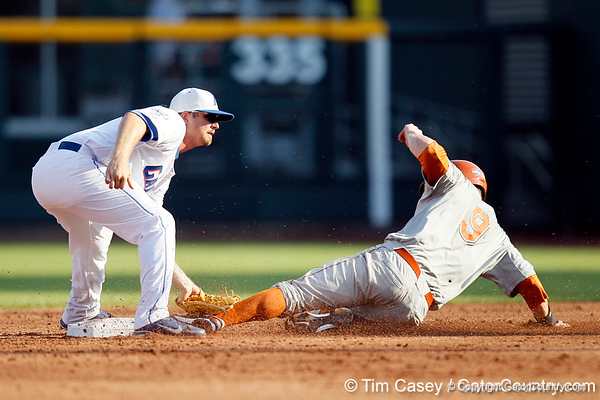 Florida senior Josh Adams tags Tant Shepherd on a stolen base during the Gators' game against the Texas Longhorns in the College World Series on Saturday, June 18, 2011 at TD Ameritrade Park in Omaha, Neb. / Gator Country photo by Tim Casey