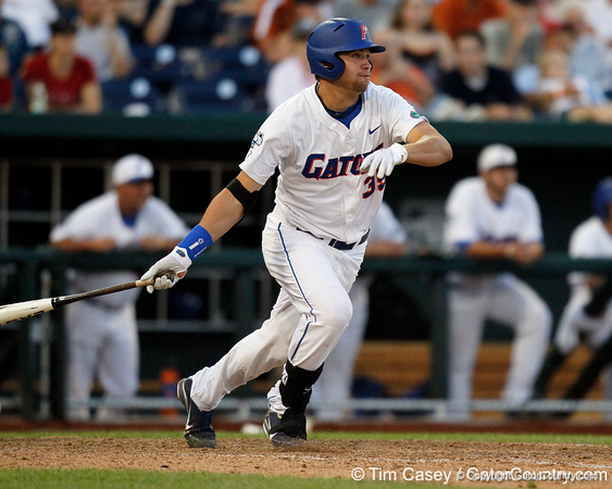 Florida sophomore Brian Johnson hits a two-run double during the Gators' 8-4 win against the Texas Longhorns in the College World Series on Saturday, June 18, 2011 at TD Ameritrade Park in Omaha, Neb. / Gator Country photo by Tim Casey