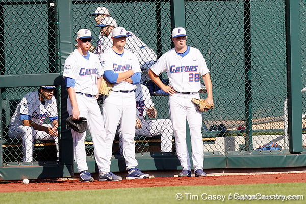 Anthony DeSclafani, Karsten Whitson and Keenan Kish watch warmups before the Gators' game against the Texas Longhorns in the College World Series on Saturday, June 18, 2011 at TD Ameritrade Park in Omaha, Neb. / Gator Country photo by Tim Casey
