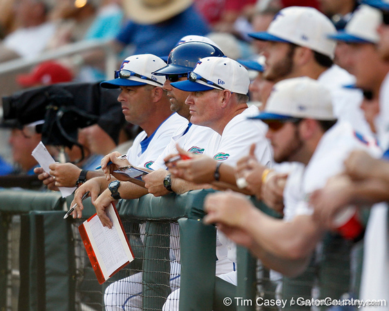 Florida baseball head coach Kevin O'Sullivan and volunteer assistant coach Don Norris look on during the Gators' game against the Texas Longhorns in the College World Series on Saturday, June 18, 2011 at TD Ameritrade Park in Omaha, Neb. / Gator Country photo by Tim Casey