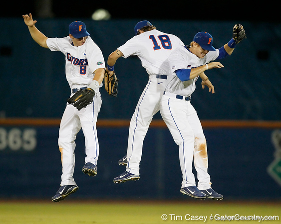 Florida junior outfielder Tyler Thompson, senior Bryson Smith and junior outfielder Tyler Thompson celebrate after the Gators' 7-0 win against the Alabama Crimson Tide on Friday, April 22, 2011 at McKethan Stadium in Gainesville, Fla. / Gator Country photo by Tim Casey