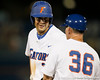 Florida sophomore Brian Johnson talks with baseball volunteer assistant coach Don Norris during the Gators' 7-0 win against the Alabama Crimson Tide on Friday, April 22, 2011 at McKethan Stadium in Gainesville, Fla. / Gator Country photo by Tim Casey