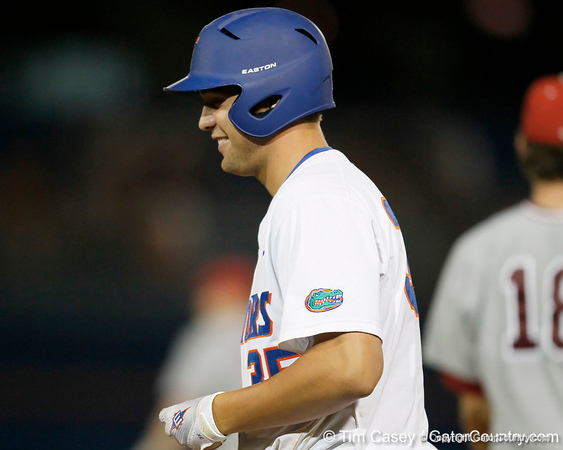 Florida sophomore Brian Johnson smiles after hitting a single during the Gators' 7-0 win against the Alabama Crimson Tide on Friday, April 22, 2011 at McKethan Stadium in Gainesville, Fla. / Gator Country photo by Tim Casey