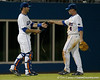 Florida junior catcher Ben McMahan brings a new belt to sophomore shortstop Nolan Fontana during the Gators' 7-0 win against the Alabama Crimson Tide on Friday, April 22, 2011 at McKethan Stadium in Gainesville, Fla. / Gator Country photo by Tim Casey