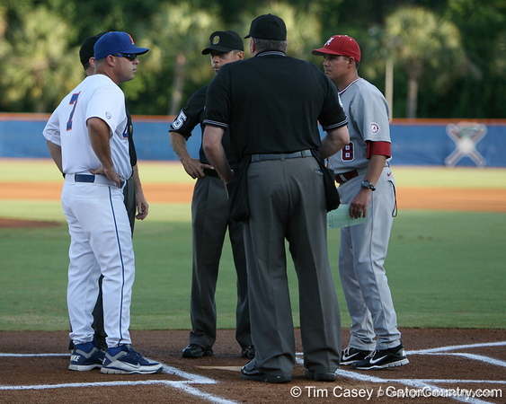 Florida baseball head coach Kevin O'Sullivan talks with umpires before the Gators' 7-0 win against the Alabama Crimson Tide on Friday, April 22, 2011 at McKethan Stadium in Gainesville, Fla. / Gator Country photo by Tim Casey