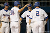 Florida sophomore Brian Johnson and sophomore catcher Mike Zunino congratulates senior Josh Adams after a three run home run during the Gators' 7-0 win against the Alabama Crimson Tide on Friday, April 22, 2011 at McKethan Stadium in Gainesville, Fla. / Gator Country photo by Tim Casey