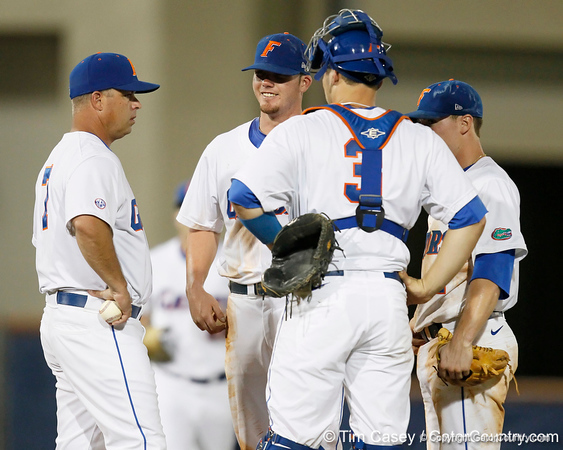 Florida baseball head coach Kevin O'Sullivan talks to Austin Maddox, Mike Zunino and Nolan Fontana during the Gators' 7-0 win against the Alabama Crimson Tide on Friday, April 22, 2011 at McKethan Stadium in Gainesville, Fla. / Gator Country photo by Tim Casey