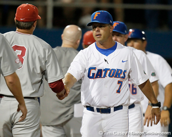 Florida baseball head coach Kevin O'Sullivan shakes hands with Alabama coaches after the Gators' 7-0 win against the Crimson Tide on Friday, April 22, 2011 at McKethan Stadium in Gainesville, Fla. / Gator Country photo by Tim Casey