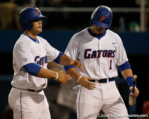 Florida senior Bryson Smith greets junior Preston Tucker at home plate after a home run during the Gators' 7-0 win against the Alabama Crimson Tide on Friday, April 22, 2011 at McKethan Stadium in Gainesville, Fla. / Gator Country photo by Tim Casey