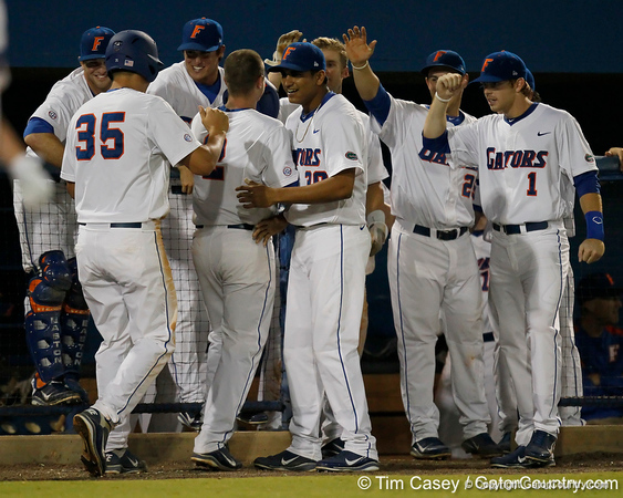 Florida players congratulate Josh Adams after he hit a three run homer during the Gators' 7-0 win against the Alabama Crimson Tide on Friday, April 22, 2011 at McKethan Stadium in Gainesville, Fla. / Gator Country photo by Tim Casey
